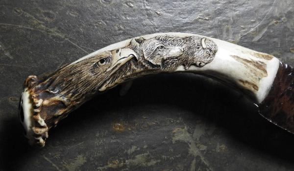 Close-Up of Eagle, Wolf and Buffalo Carved in Antler Knife Handle